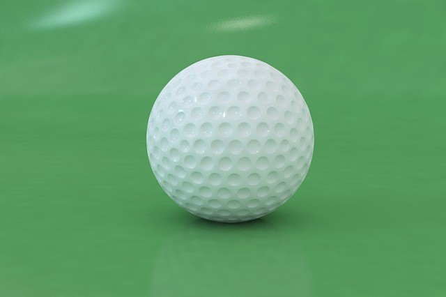 Golfing Facts – Golf Ball Close Up Green Background